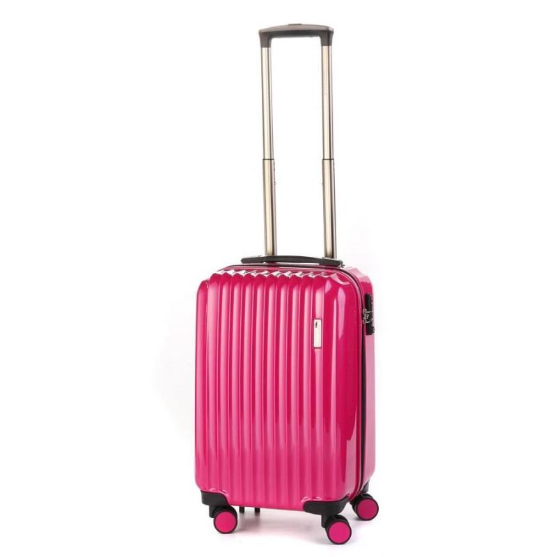 Маленький пластиковый чемодан на четырех колесах розовый